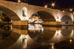 Roma, Bridge on Tiber River with Sant Angelo Castle at Night, with Lights and Reflections royalty free stock photos