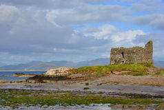 Rruins of castle on the beach. Ireland Stock Photo