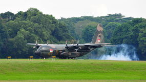 RSAF C-130 military transport plane landing Royalty Free Stock Images