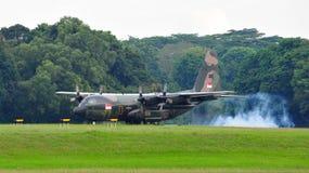 RSAF C-130 military transport plane landing Royalty Free Stock Images