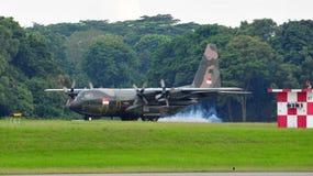 RSAF C-130 military transport plane landing Stock Image