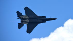 RSAF F-15SG figher jet performing aerobatics at Singapore Airshow Stock Photos