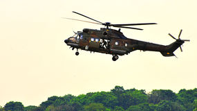 RSAF Super Puma helicopter approaching airfield Stock Photos