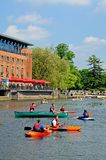 RSC and canoeists, Stratford-upon-Avon. Royalty Free Stock Photography