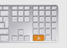 RSS feed icon concept. On metallic keyboard stock photo
