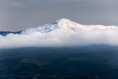 Rtanj mountain covered with low clouds Royalty Free Stock Image