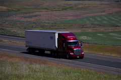 RTI Trucking / Red Peterbilt White Trailer. 