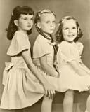 Rétro verticale de trois filles Photographie stock
