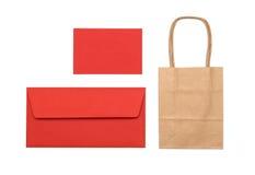 Rött kuvert och påse Arkivbild