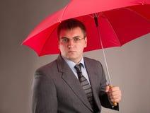 Rött paraply Arkivbild