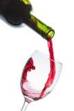 Rött vinexponeringsglas Arkivfoto