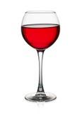 Rött vinexponeringsglas som isoleras på den vita bakgrunden Royaltyfri Foto
