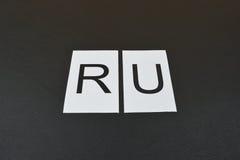 ` Ru ` символа на черной предпосылке Стоковые Изображения