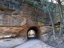 Rua através do furo da rocha Fotografia de Stock Royalty Free