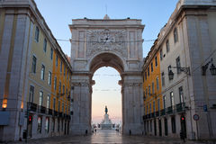 Rua Augusta Arch at Dawn in Lisbon. Portugal. Statue of King Jose I on Commerce Square at the far end Royalty Free Stock Photo