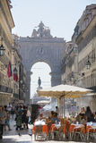 Rua Augusta and the Augusta Arch Lisbon. Pavement cafes and shops in Rua Augusta Lisbon Royalty Free Stock Photo