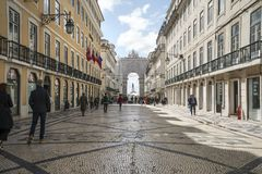Rua Augusta in Lisbon. People walking along the Rua Augusta, with the arco da Vitoria in the background in Lisbon, Portugal Royalty Free Stock Image