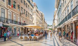 Rua Augusta in a summer afternoon, Lisbon, Portugal. Rua Augusta is the main tourist street of Lisbon, leading the the famous Praca do Comercio Royalty Free Stock Photos
