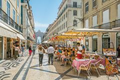 Rua Augusta in a summer afternoon, Lisbon, Portugal. Rua Augusta is the main tourist street of Lisbon, leading the the famous Praca do Comercio Stock Photo