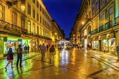 Rua Augusta Evening Walking Shopping Street Baixa Lisbon Portuga. Rua Augusta Street Evening Walking Shopping Street Black White Tiles Shops Restaurants Baixa Royalty Free Stock Photo