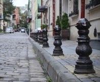 Rua cobbled velha com as trilhas do bonde na baixa de Lviv Foto de Stock Royalty Free