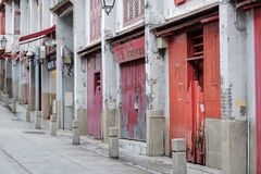 Rua da Felicidade road or Street of Happiness, red doors and window of traditional Chinese houses. landmark and popular for royalty free stock photography
