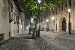 Rua em Bucareste - cena da noite Fotografia de Stock Royalty Free