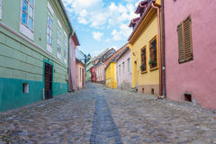 Rua em Sighisoara, a Transilvânia Imagens de Stock