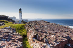 Rua Reidh Lighthouse and rocks. Rua Reidh Lighthouse showing the craggy rocks on which it sits Stock Photos