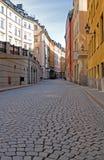 Rua velha do cobblestone da cidade. Foto de Stock