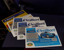 Ruanair Scratch cards on a plane seat table. Royalty Free Stock Photos