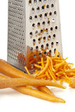 Rub carrots and grater Royalty Free Stock Photography