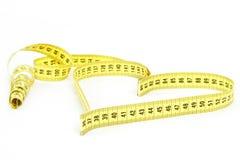 Ruban métrique de forme de coeur - santé, concept de poids Images stock