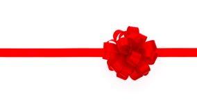 Ruban rouge brillant sur le fond blanc avec l'espace de copie photo libre de droits