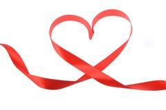 Ruban rouge de coeur d'isolement Photo stock