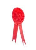 Ruban rouge de récompense de tissu d'isolement sur le blanc Images stock
