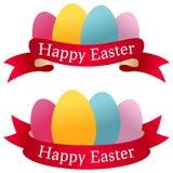 Rubans heureux de Pâques avec des oeufs Photos stock