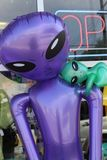 Rubber Alien in Roswell New Mexico. Purple rubber plastic alien with baby on display in Roswell New Mexico, the UFO capital of the United States Stock Images