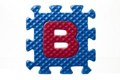Rubber alphabet puzzle with letter b Royalty Free Stock Photo
