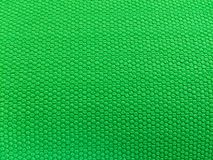 Rubber als achtergrond, ruwe oppervlakte, groene achtergrond stock afbeelding