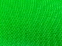 Rubber als achtergrond, ruwe oppervlakte, groene achtergrond stock foto's