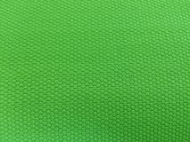 Rubber als achtergrond, ruwe oppervlakte, groene achtergrond stock fotografie