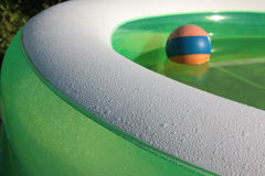 Rubber ball. Colorful rubber ball in an inflatable pool Royalty Free Stock Photos