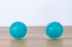 Rubber balls for foot massage. On a wood floor Royalty Free Stock Images