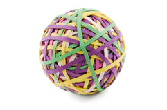 Rubber band ball. A ball of colorful rubber bands isolated on white Royalty Free Stock Image