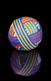 Rubber band ball on black surface Royalty Free Stock Photography