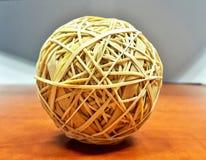 Rubber band ball on a desk stock photos