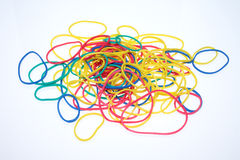 Rubber band. A lot of colorful rubber bands over white Stock Photography