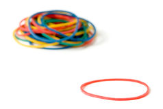 Rubber band standing out Stock Images