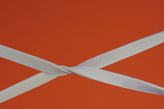 Rubber bands elastic with a orange background Royalty Free Stock Photo